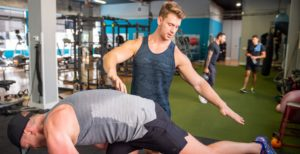 trainer helping client with form